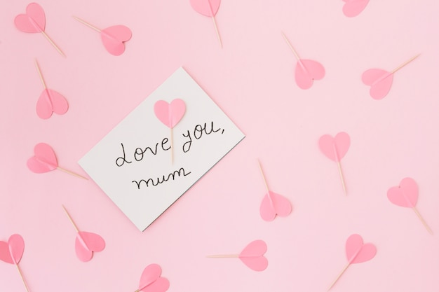 Love you mum inscription with paper hearts