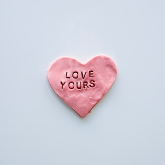Love yours inscription on pink heart cookie
