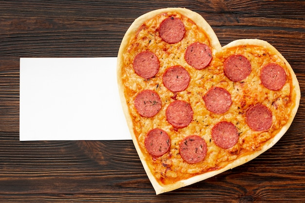 Lovely arrangement for valentines day dinner with heart shaped pizza and card