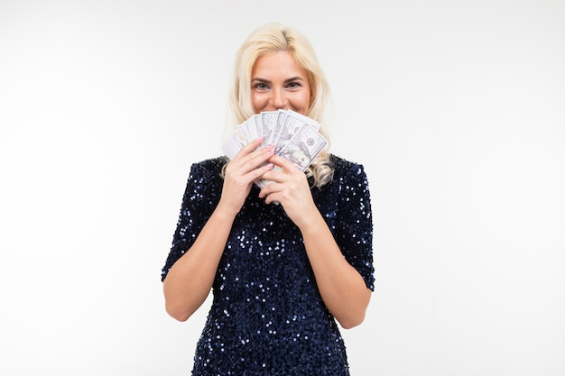 Lovely blonde with a cash loan on a white background