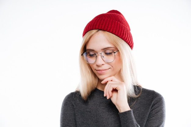 Lovely blonde woman in hat and glasses looking away