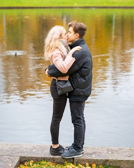 Lovely brunette guy and pretty girl blonde drink coffee and talking on date. loving teenagers