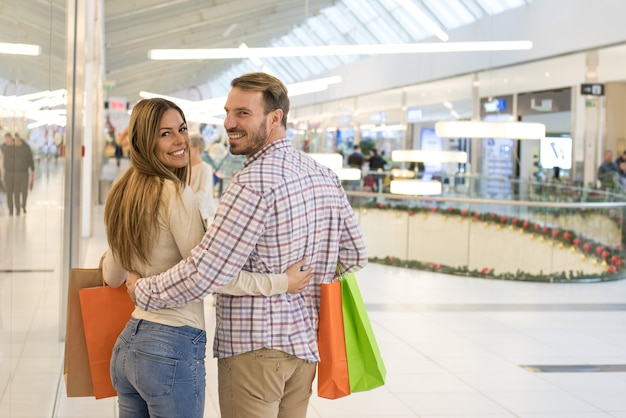 Lovely caucasian couple doing shopping in a shopping centre