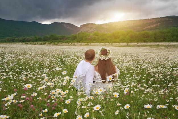 Lovely couple in daisy meadow.