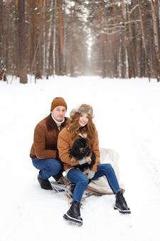 Lovely couple and dog enjoying wintertime