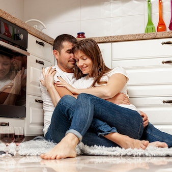 Lovely couple embracing in kitchen