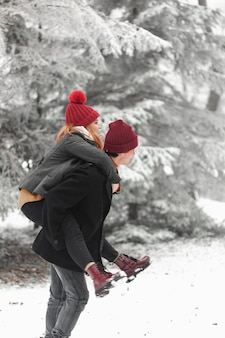 Lovely couple fooling around in the snow sideways