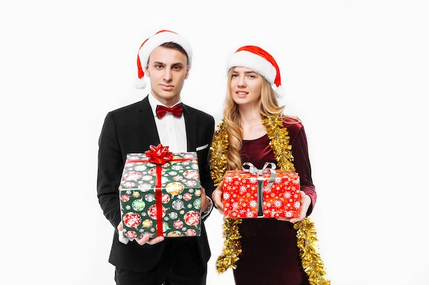 Lovely couple giving christmas gifts