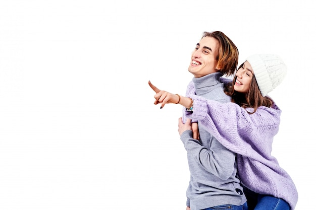 Lovely couple having fun while man piggybacking his girlfriend