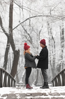 Lovely couple holding hands on a bridge