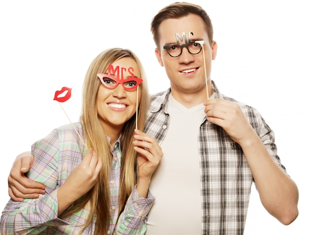 Lovely couple holding party glasses on stick