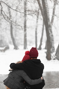 Lovely couple hugging outdoors medium shot