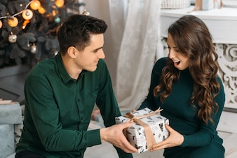 Lovely couple in love admiring present