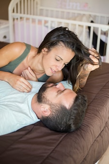 Lovely couple lying on bed