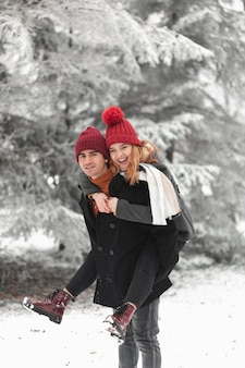 Lovely couple playing outside in the winter
