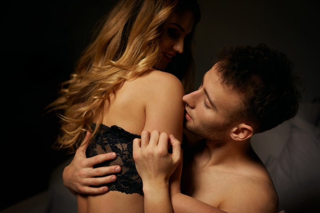 Lovely couple posing in bed