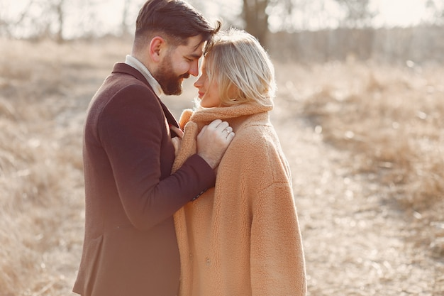 Lovely couple in a spring field