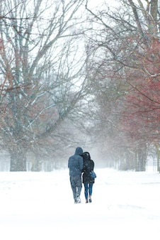 Lovely couple walking together in the snow.