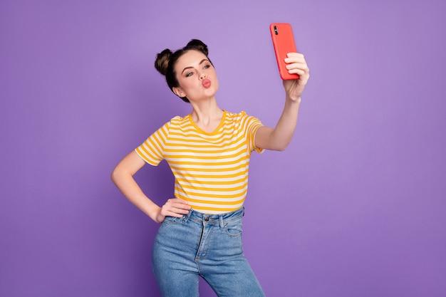 Lovely cute girlfriend hold telephone take selfie send air kiss