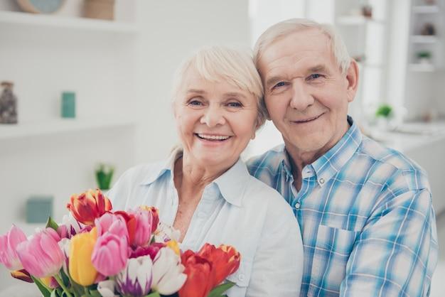 Lovely elderly couple at home