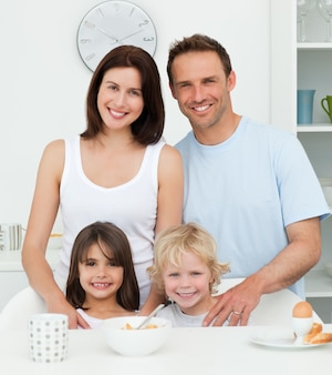 Lovely family during breakfast in the kitchen