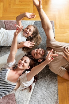 Lovely family laying on the floor