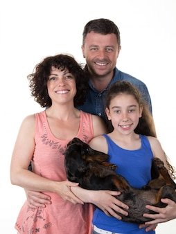 Lovely family looking  with their dog