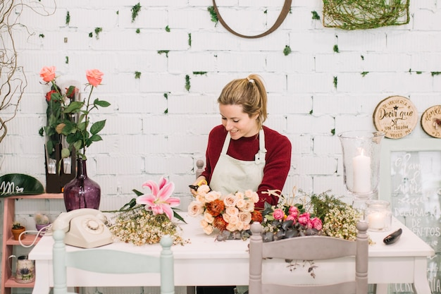 Lovely florist making bouquets