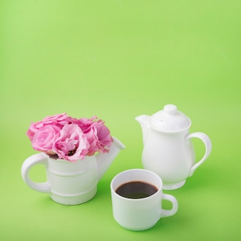 Lovely flowers concept with coffee cup