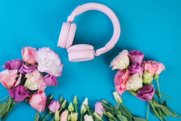 Lovely flowers concept with earphones