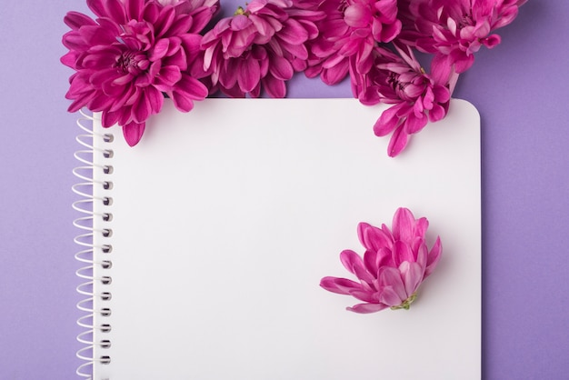 Lovely flowers concept with modern notebook