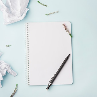 Lovely flowers concept with notebook