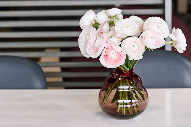 Lovely flowers in glass vase. beautiful bouquet of pink persian buttercup.