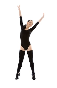 Lovely girl in black leotard working out over white