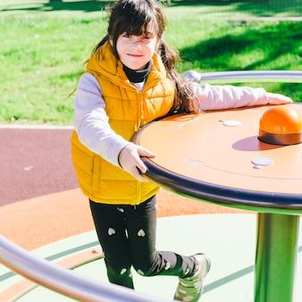 Lovely girl on merry-go-round