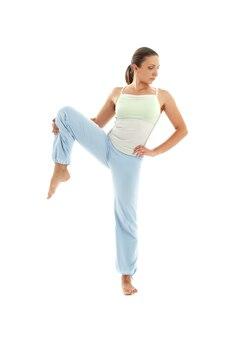 Lovely girl practicing ashtanga yoga over white