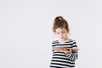 Lovely girl with tablet