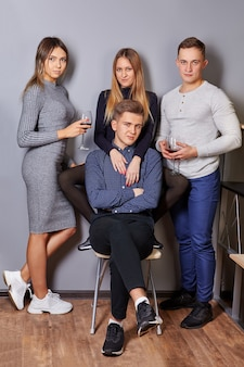 Lovely girls and attractive men posing for photographer at event.