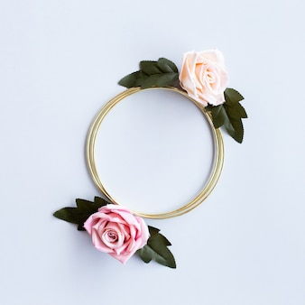 Lovely greeting wedding with roses flowers and golden circle