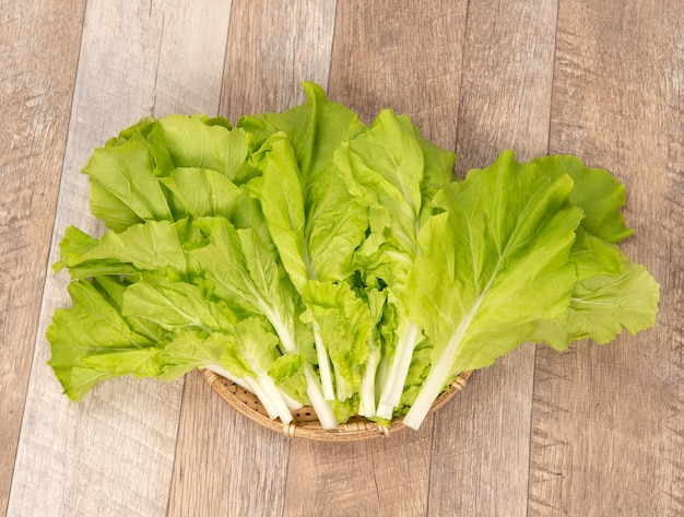 Lovely and healthy vagetables (chinese cabbage or bok-choy) in wooden background