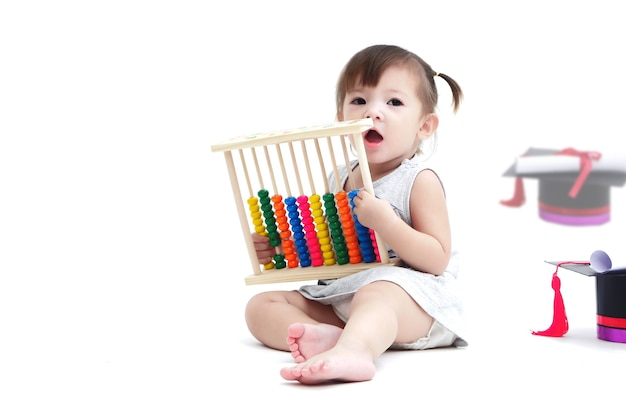 The lovely kid playing with abacus