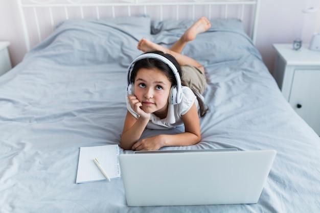 Lovely little girl using her laptop