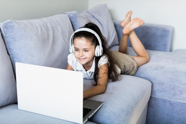Lovely little girls using her laptop