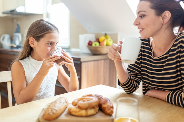 Lovely mother and daughter in the kitchen