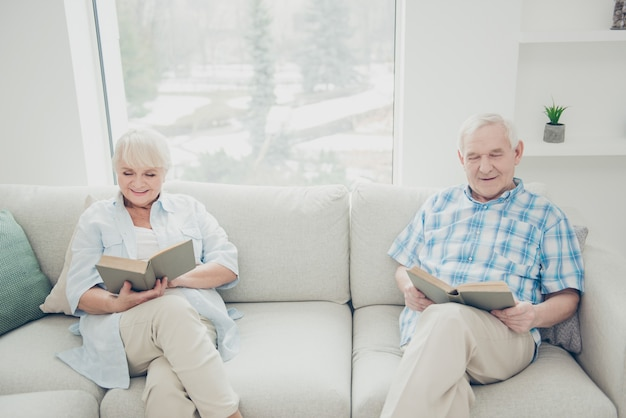Lovely older couple posing together on the couch