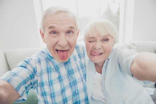 Lovely older couple posing together indoors