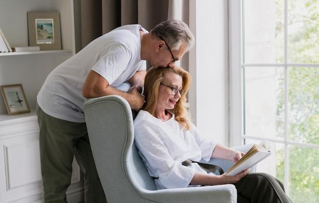 Lovely senior man kissing woman