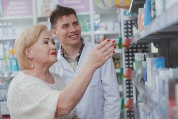 Lovely senior woman shopping at drugstore