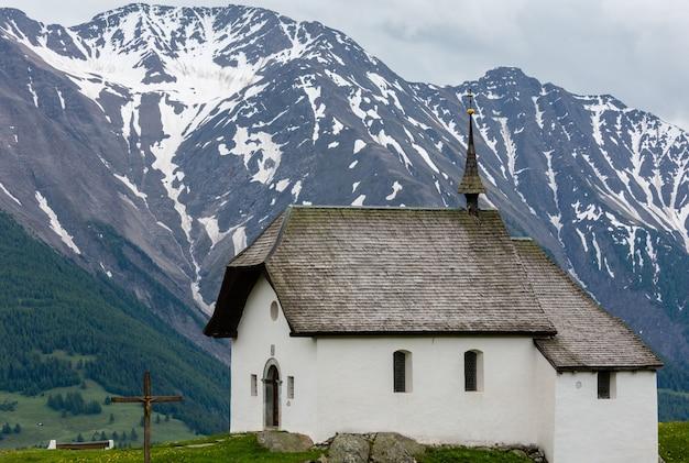 Lovely small old church in bettmeralp alps mountain village, switzerland