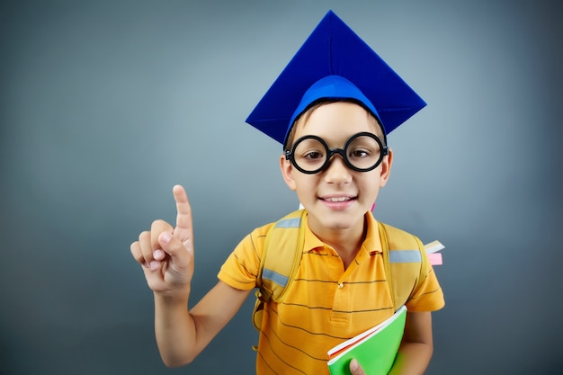 Lovely student with blue graduation cap